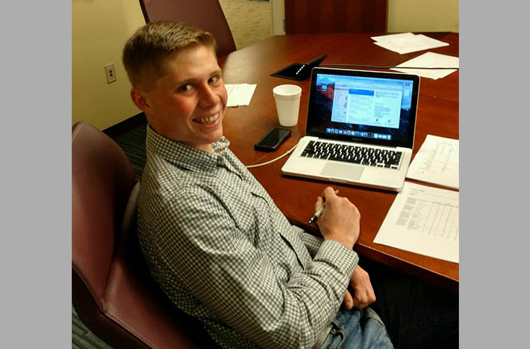 Cory Massey at computer station