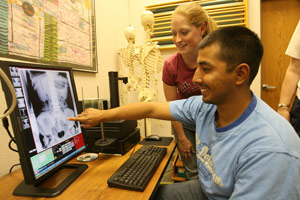 Students analyze xray on computer