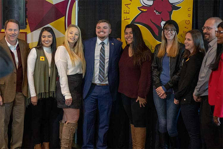 Picture of first-generation students and President Foster