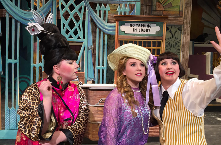 Three actress from Thoroughly Modern Millie during a dress rehearsal